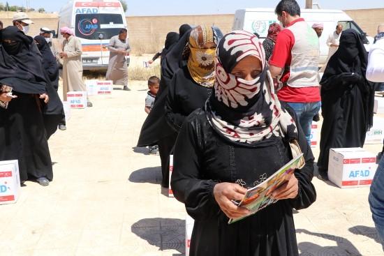 Telabyad'da altı köye insani yardımlar ulaştırıldı (Video)